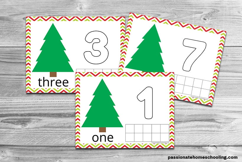 3 Christmas playdough mats for numbers 1, 3, and 7 on a wooden table background.