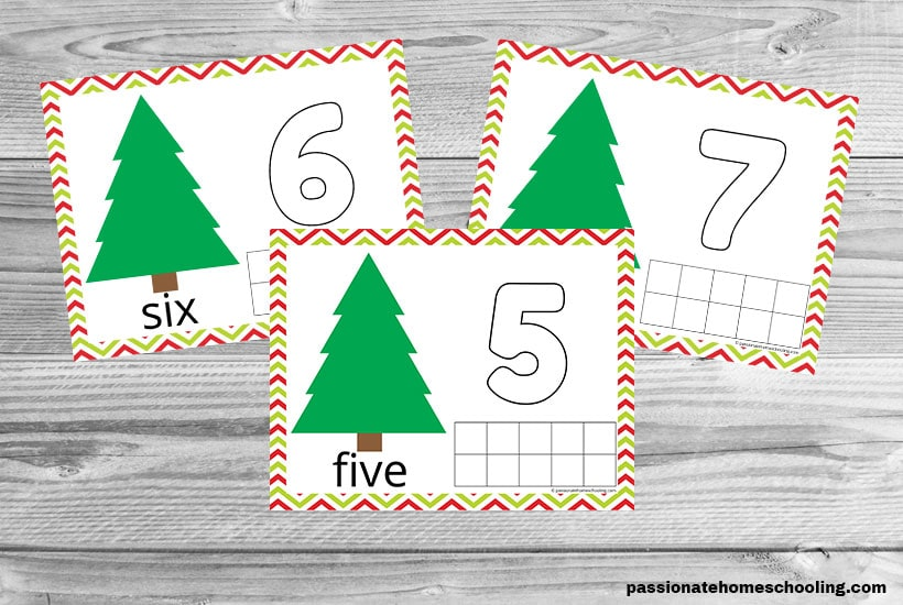 3 Christmas playdough mats for numbers 5, 6, and 7 on a wooden table background.