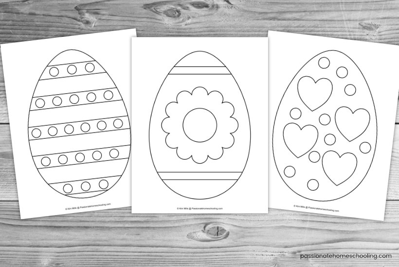 Easter egg coloring pages on a wooden table background.