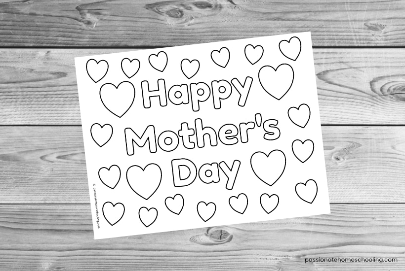 Happy Mother's Day coloring page filled with hearts sample image on a wooden background.